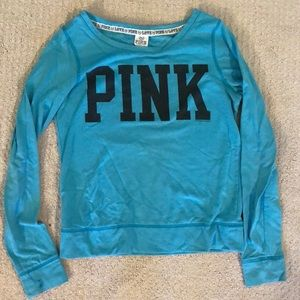 A blue crew neck sweater